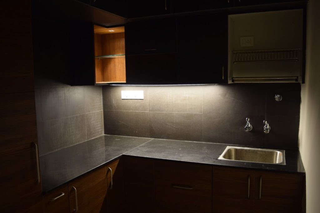 Black and wooden modular kitchen