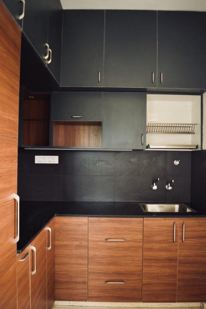 Black and wooden modular kitchen. interior goals